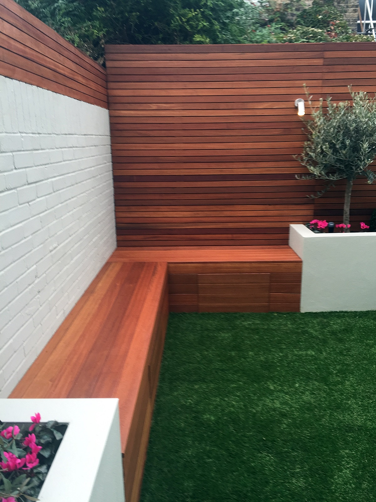 raised block render walls fake grass hardwood storage bench olive tree privacy screen trellis battersea clapham balham wandsworth fulham chelsea london