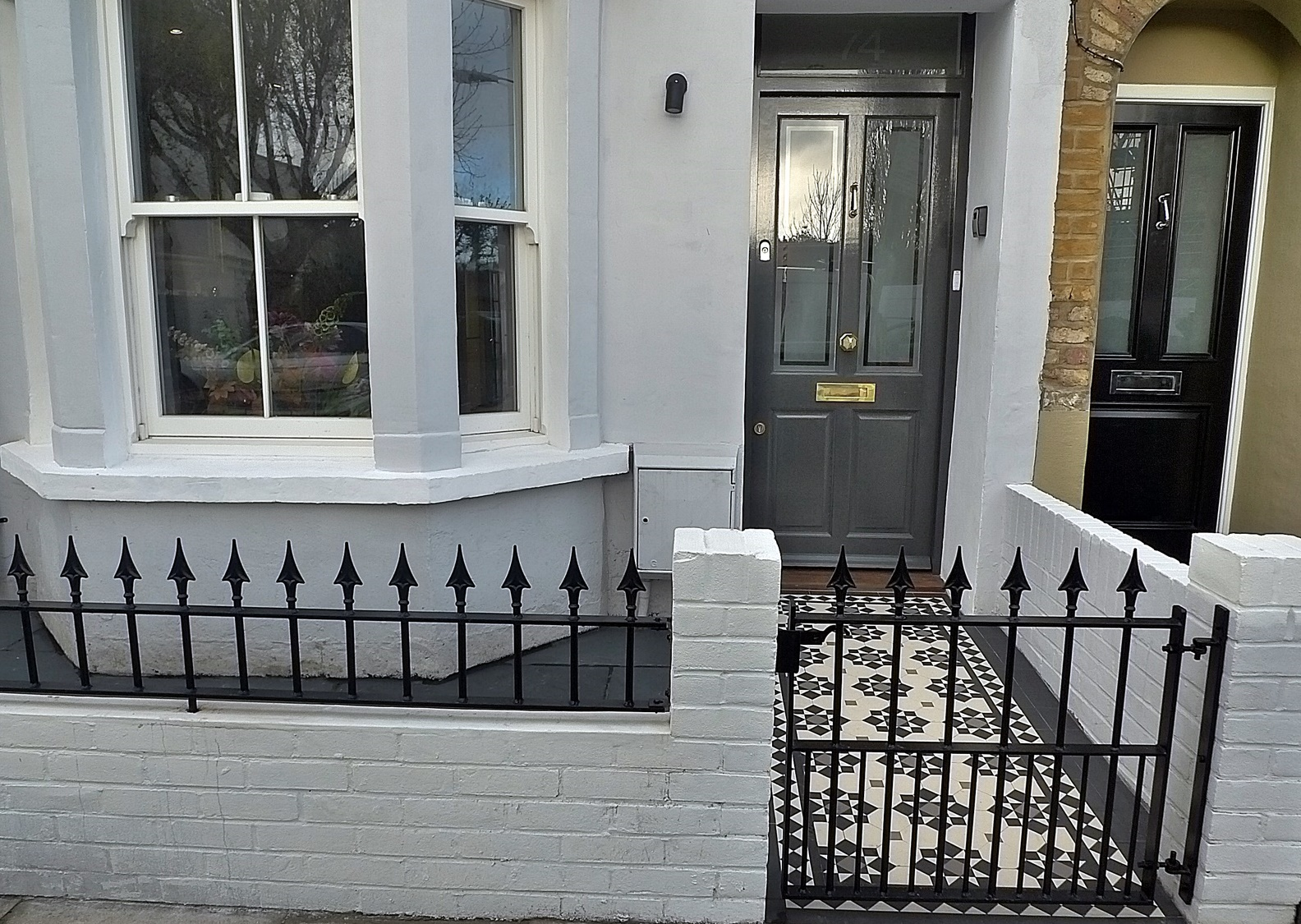 Plastered Rendered Front Garden Wall Painted White Metal Wrought Iron Rail  And Gate Victorian Mosaic Tile Path In Black And White Scottish Pebbles U2026
