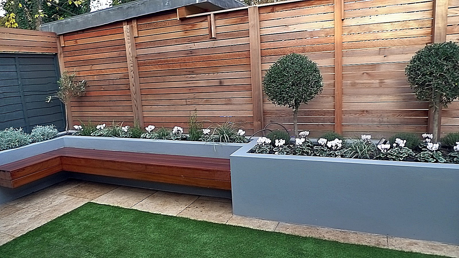 Modern garden design London easy grass fake formal trellis raised beds Chelsea Fulham Streatham