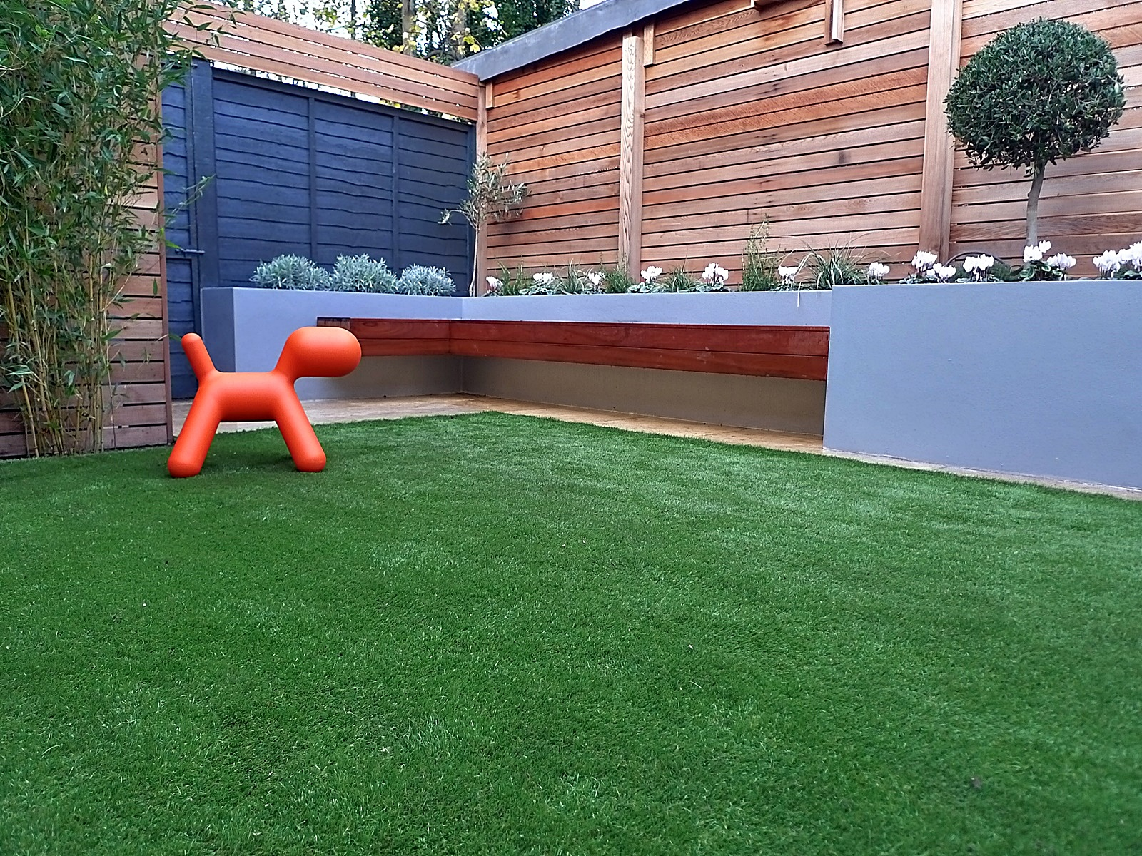 Raised beds cedar screen fence easy fake grass topiary London grey walls Dulwich Clapham Chelsea