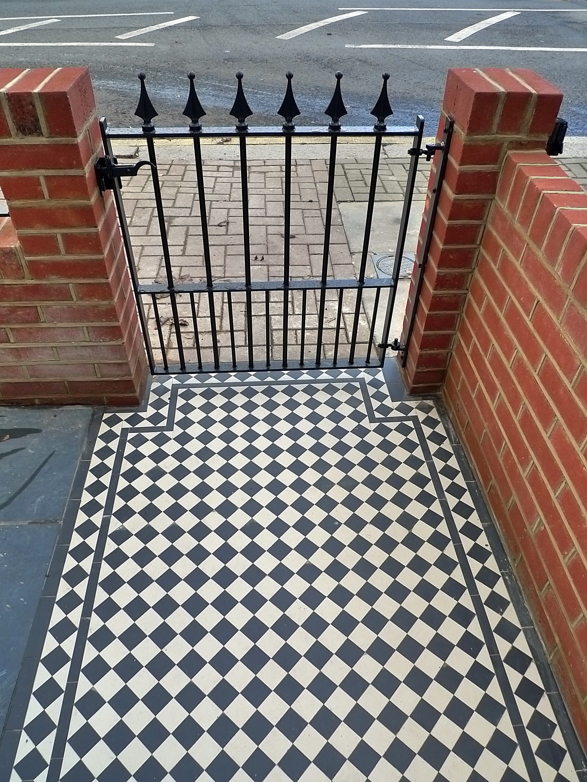 Victorian black and white mosaic London front garden company red brick walls Earsfield Blahma Clapham Wandsworth