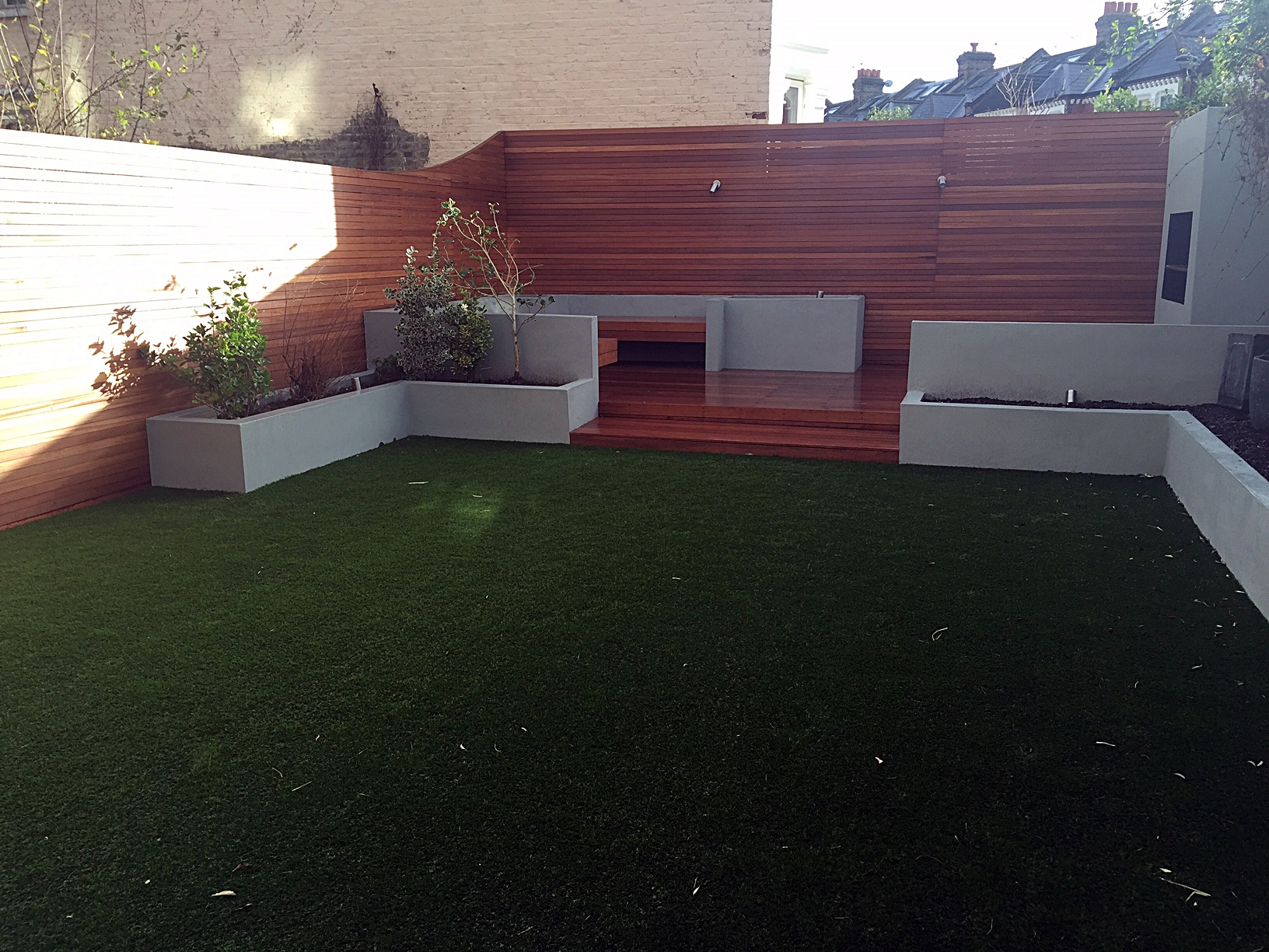 Artificial grass Balham raised beds hardwood privacy screen grey colour BBQ fireplace London Clapham Battersea