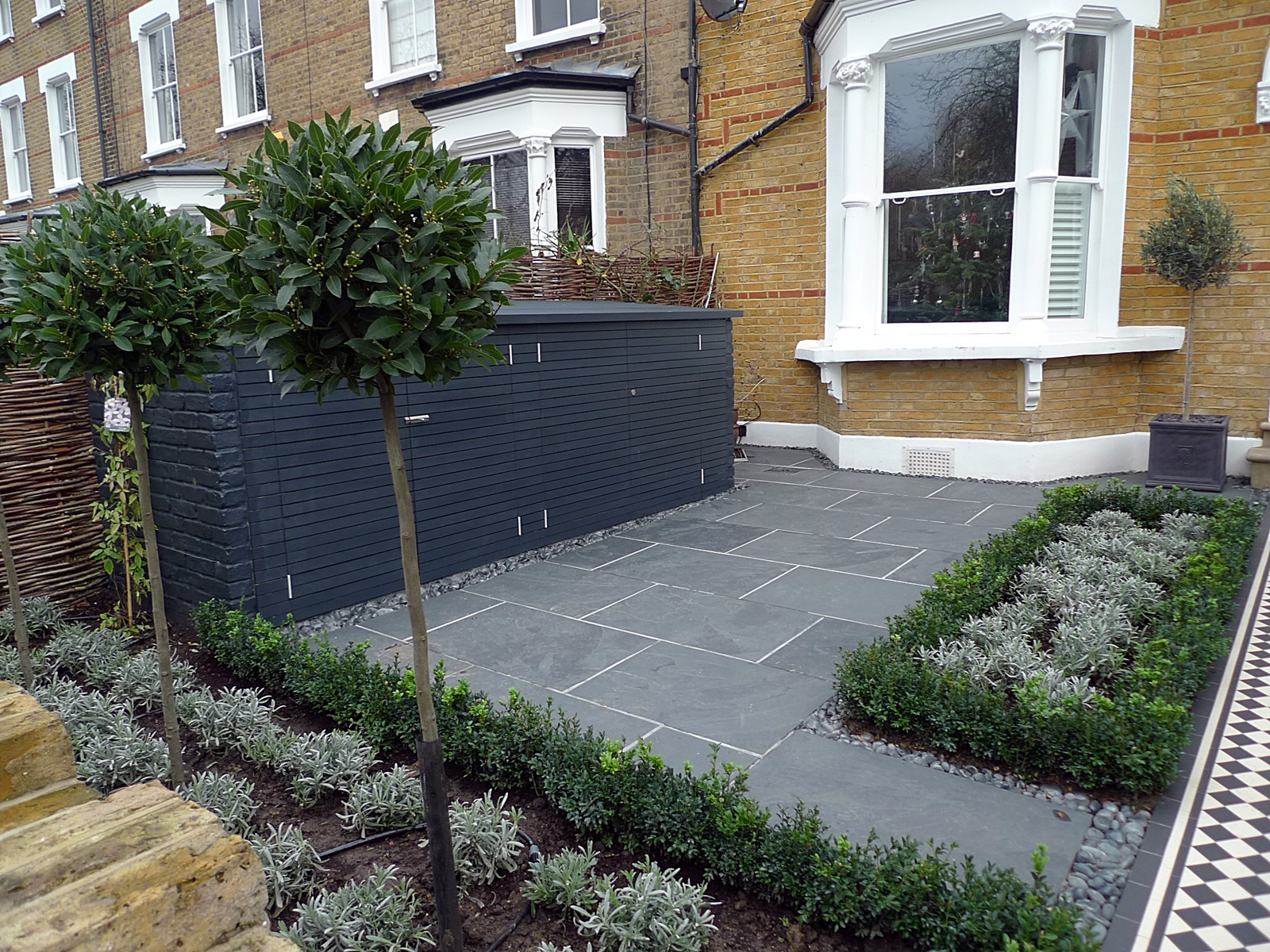 bespoke charcoal bin bike storage slate paving knot garden victorian mosaic tile path hackney islington southwark lambeth london