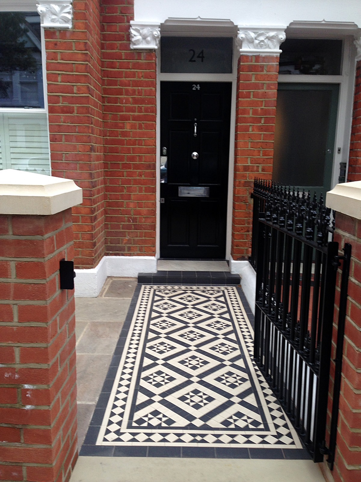 red brick front garden wall yellow stone caps sandstone paving victorian mosaic tile path hyde park mayfair bayswater earls court west london