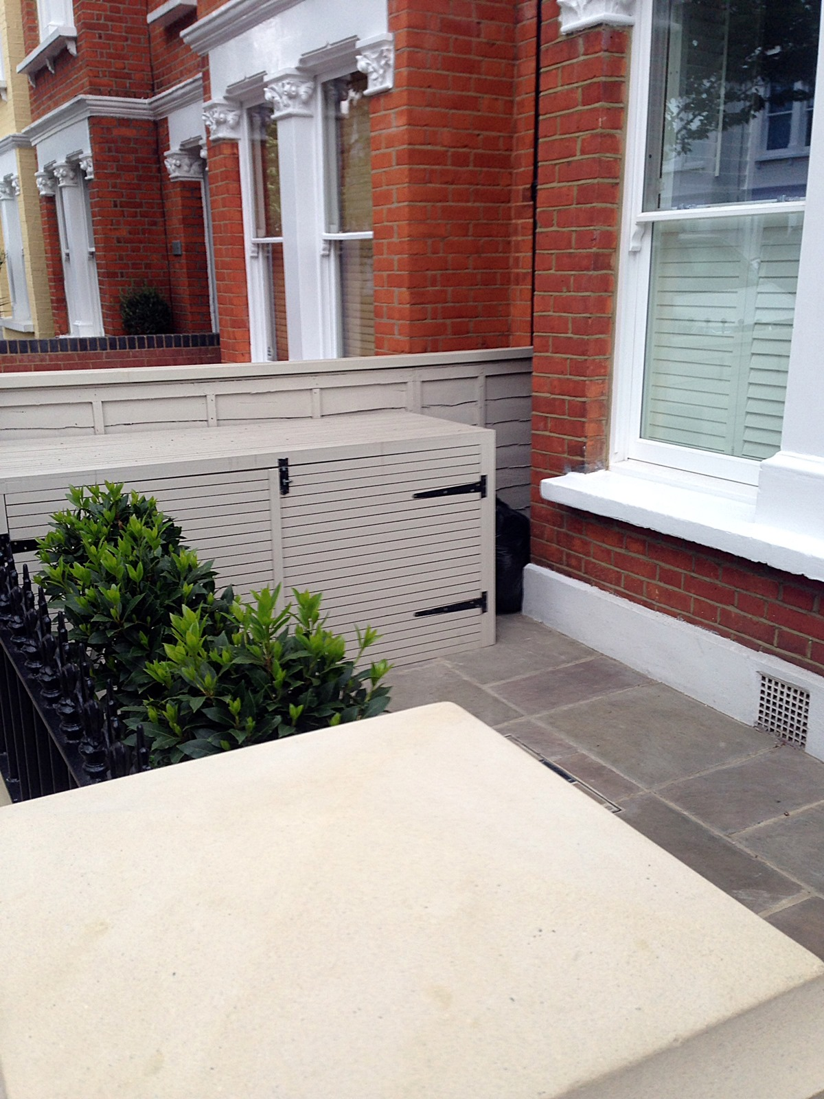 red brick front garden wall yellow stone caps sandstone paving victorian mosaic tile path kensington london