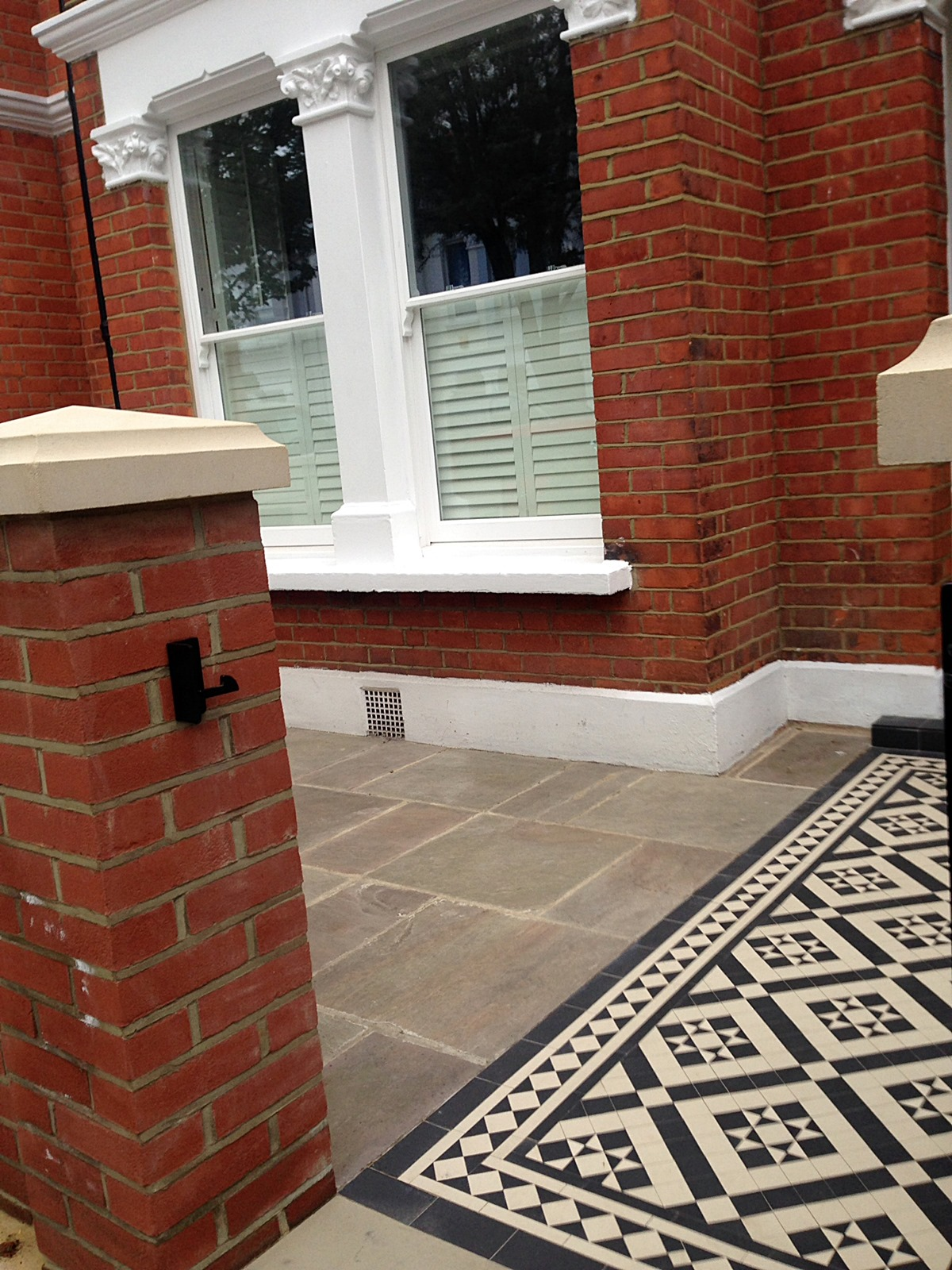 red brick front garden wall yellow stone caps sandstone paving victorian mosaic tile path pimlico london