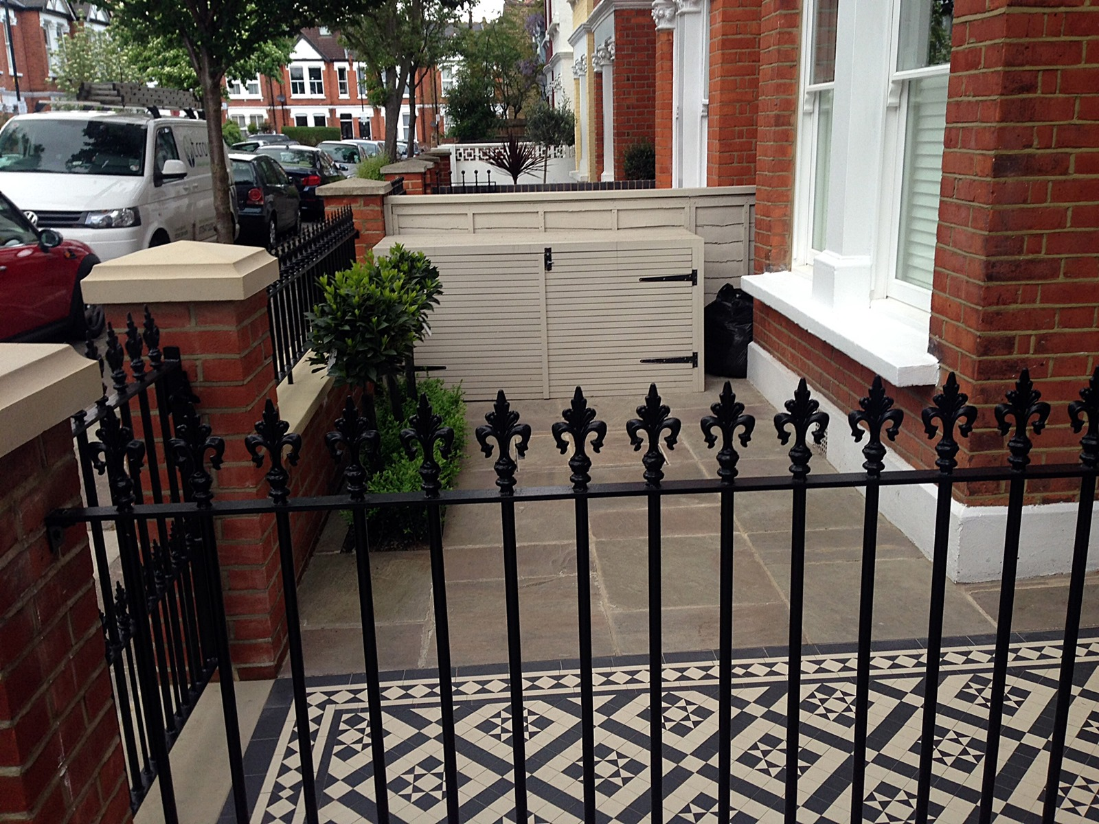 red brick front garden wall yellow stone caps sandstone paving victorian mosaic tile path putney clapham london