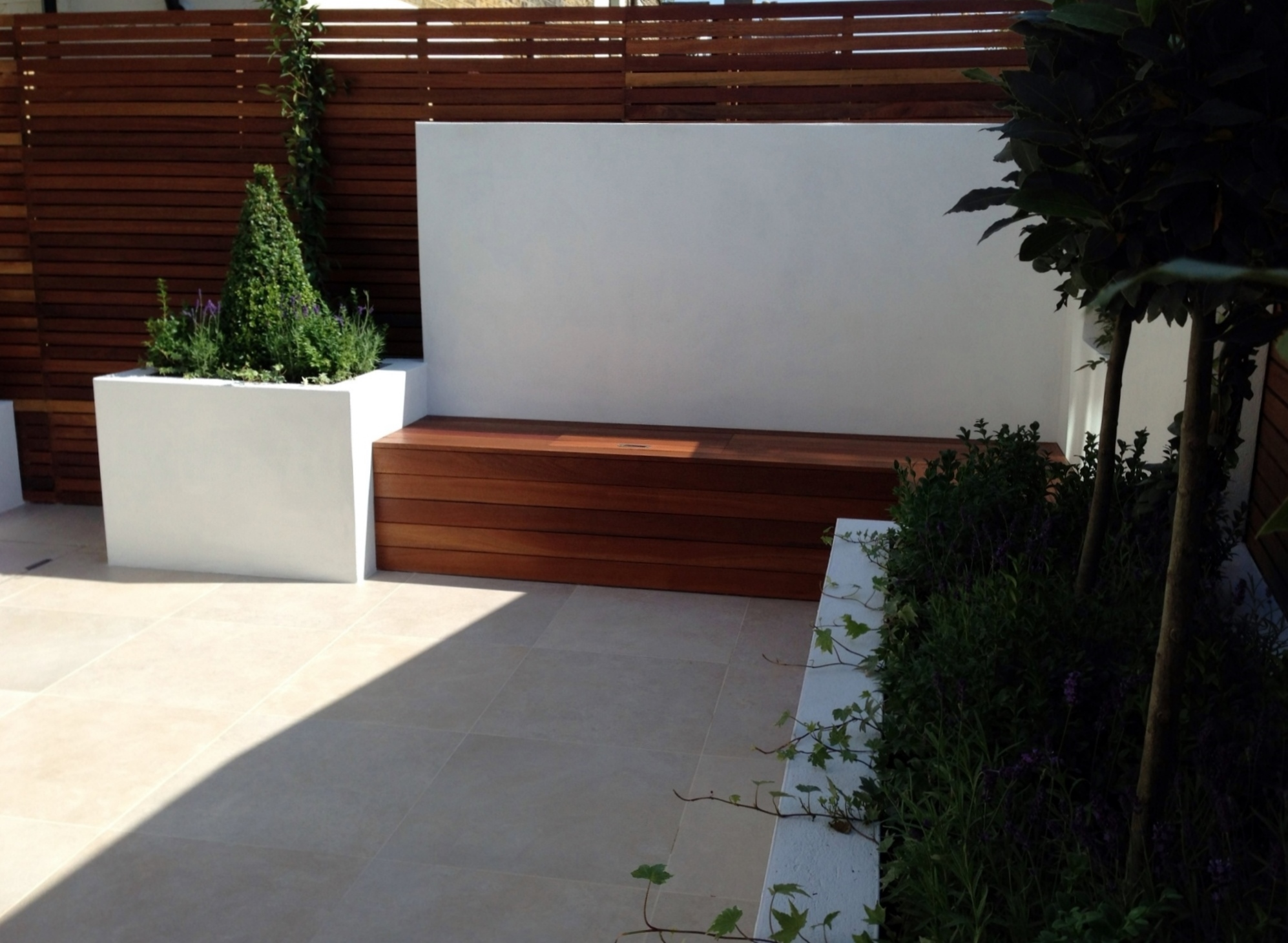 small garden design london dulwich ideas low maintenance grey tiles render plaster walls hardwood bench