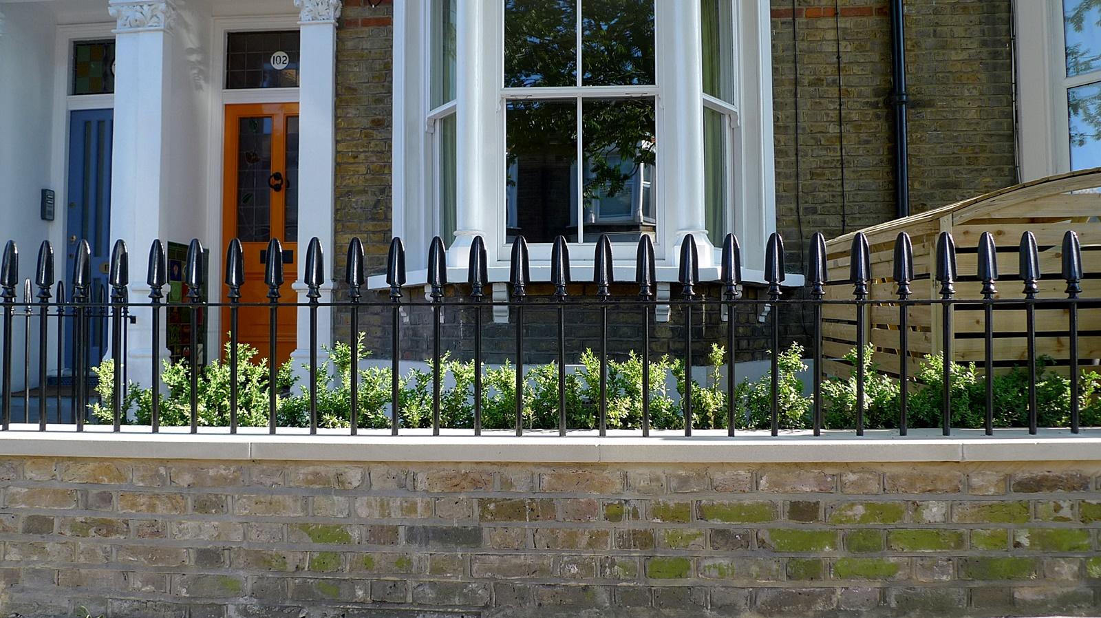 wrought iron rail and gate yellow stock brick wall victorian mosaic yorkstone battersea london