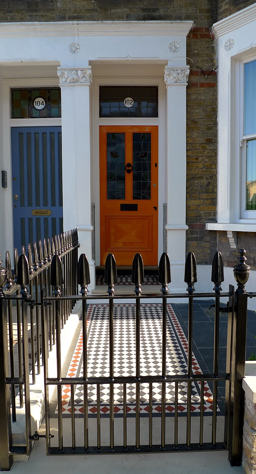 wrought iron rail and gate yellow stock brick wall victorian mosaic yorkstone clapham london