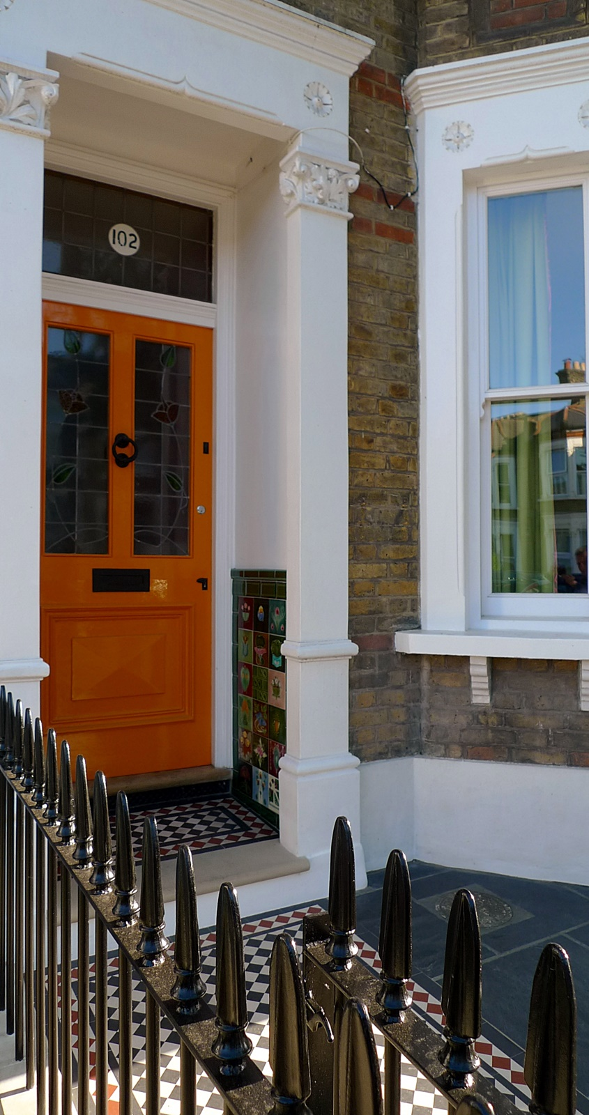 wrought iron rail and gate yellow stock brick wall victorian mosaic yorkstone dulwich herne hill london