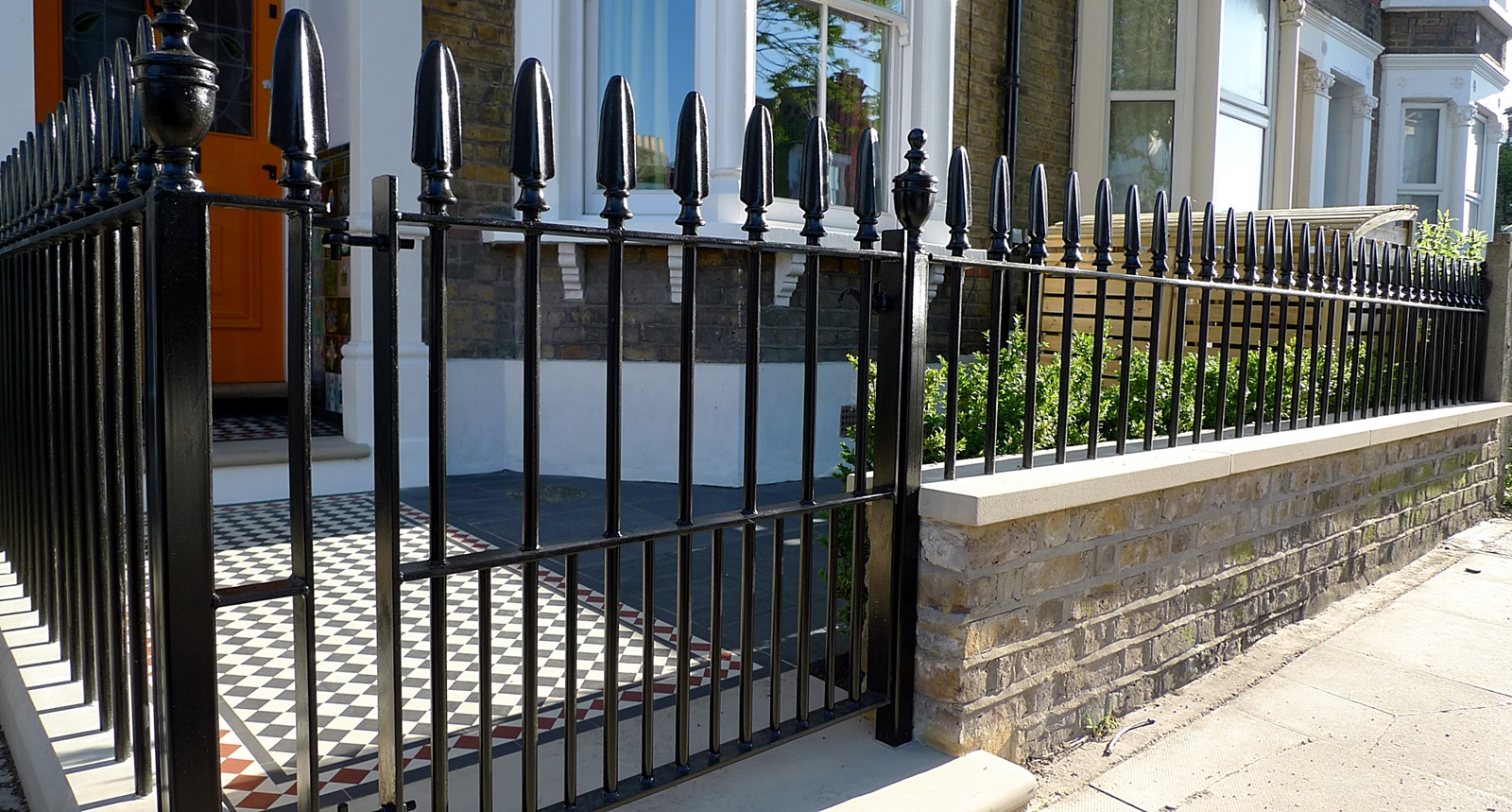 wrought iron rail and gate yellow stock brick wall victorian mosaic yorkstone fulham chelsea london