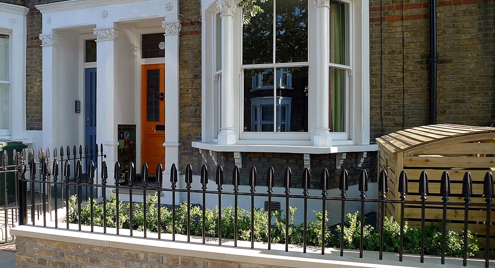 wrought iron rail and gate yellow stock brick wall victorian mosaic yorkstone kensington london