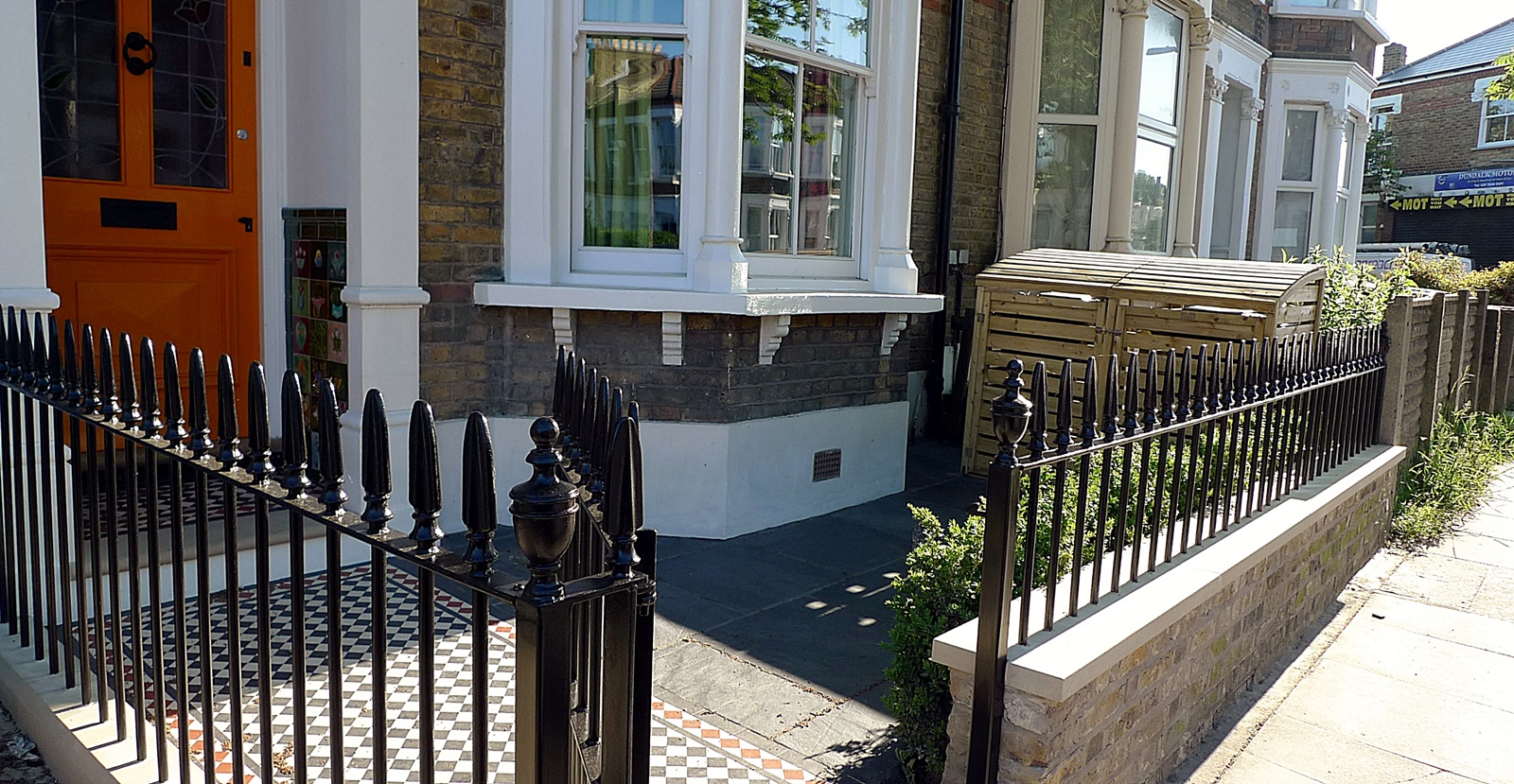 wrought iron rail and gate yellow stock brick wall victorian mosaic yorkstone mayfair hyde park london