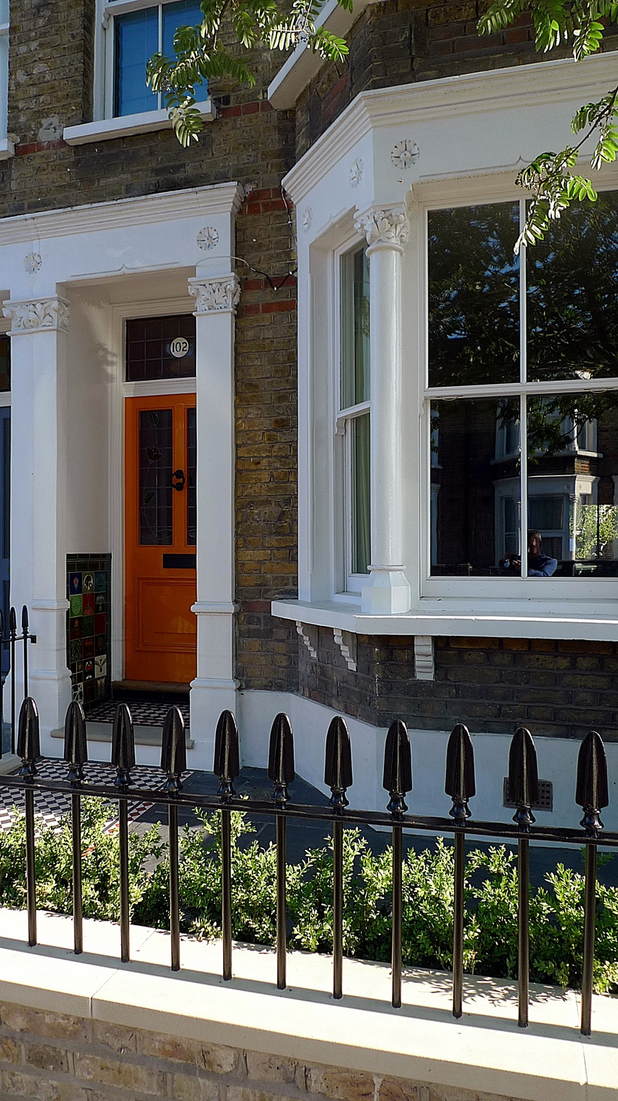 wrought iron rail and gate yellow stock brick wall victorian mosaic yorkstone notting hill london