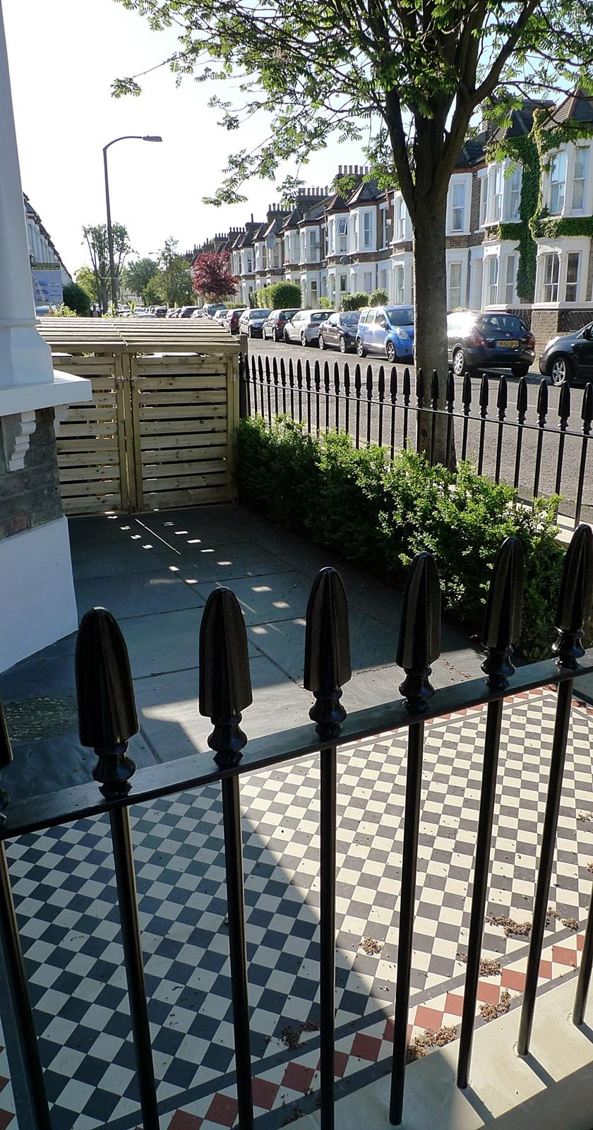 wrought iron rail and gate yellow stock brick wall victorian mosaic yorkstone pimlico london