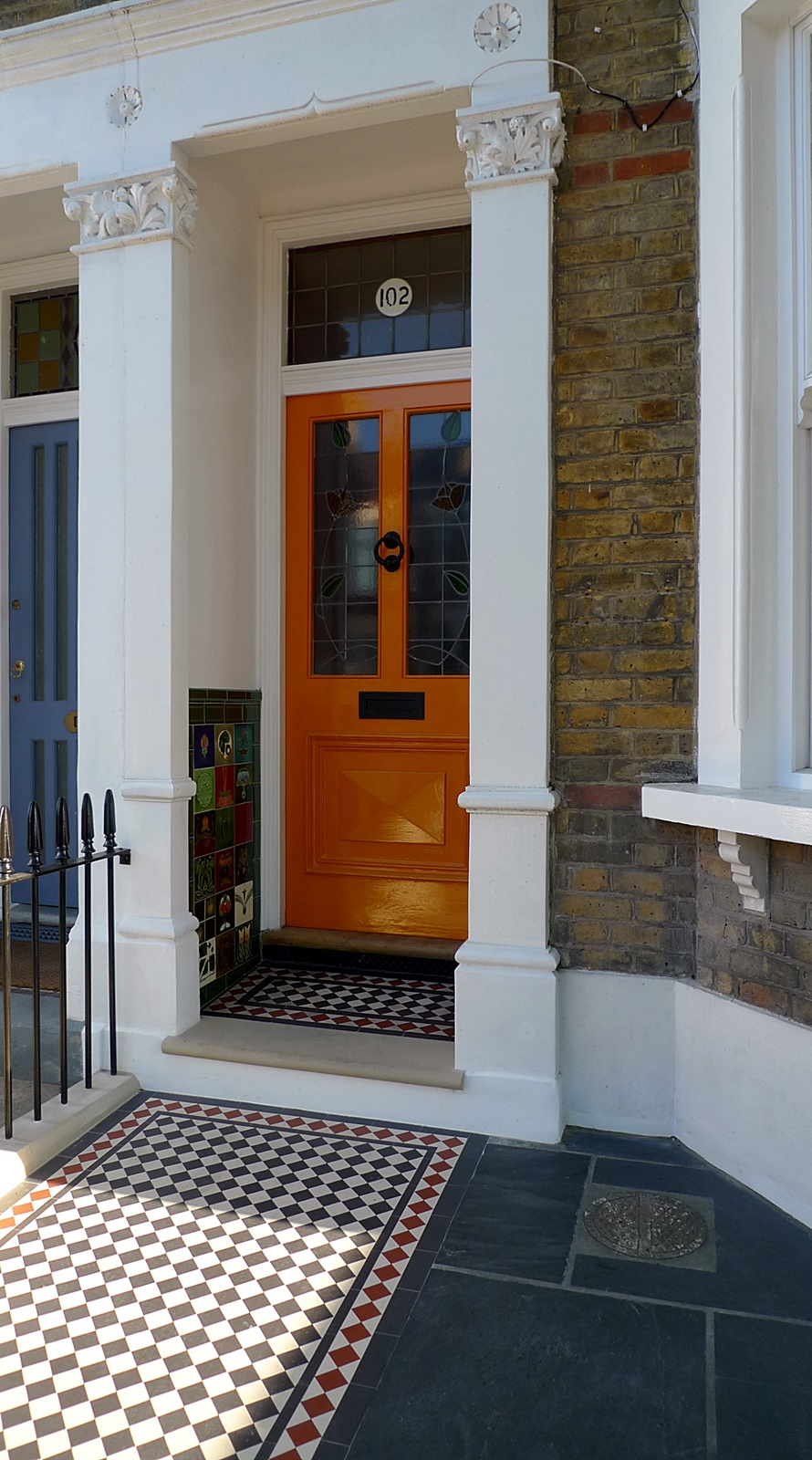 wrought iron rail and gate yellow stock brick wall victorian mosaic yorkstone westminster soho london