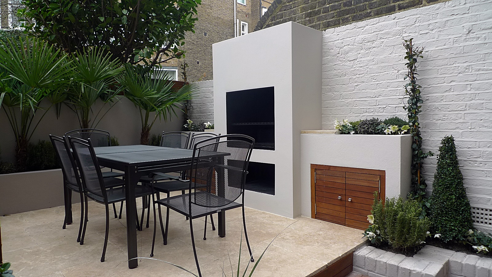 BBQ outdoor fire place cream paving modern courtyard garden design London chelsea kensington fulham mayfair