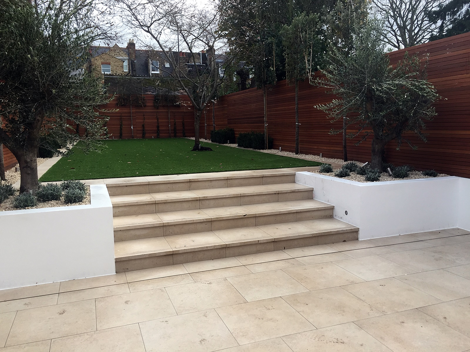 Fulham Chelsea travertine artificial grass path tile wall trellis London lighting