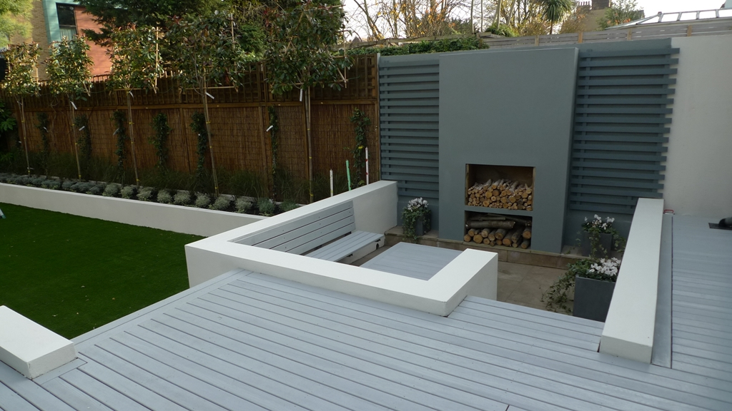 Grey deck low maintenance white raised beds privacy screen London Garden Design Company