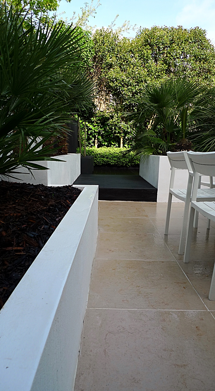 Floating black bench topiary planting limestone tile buxus ...