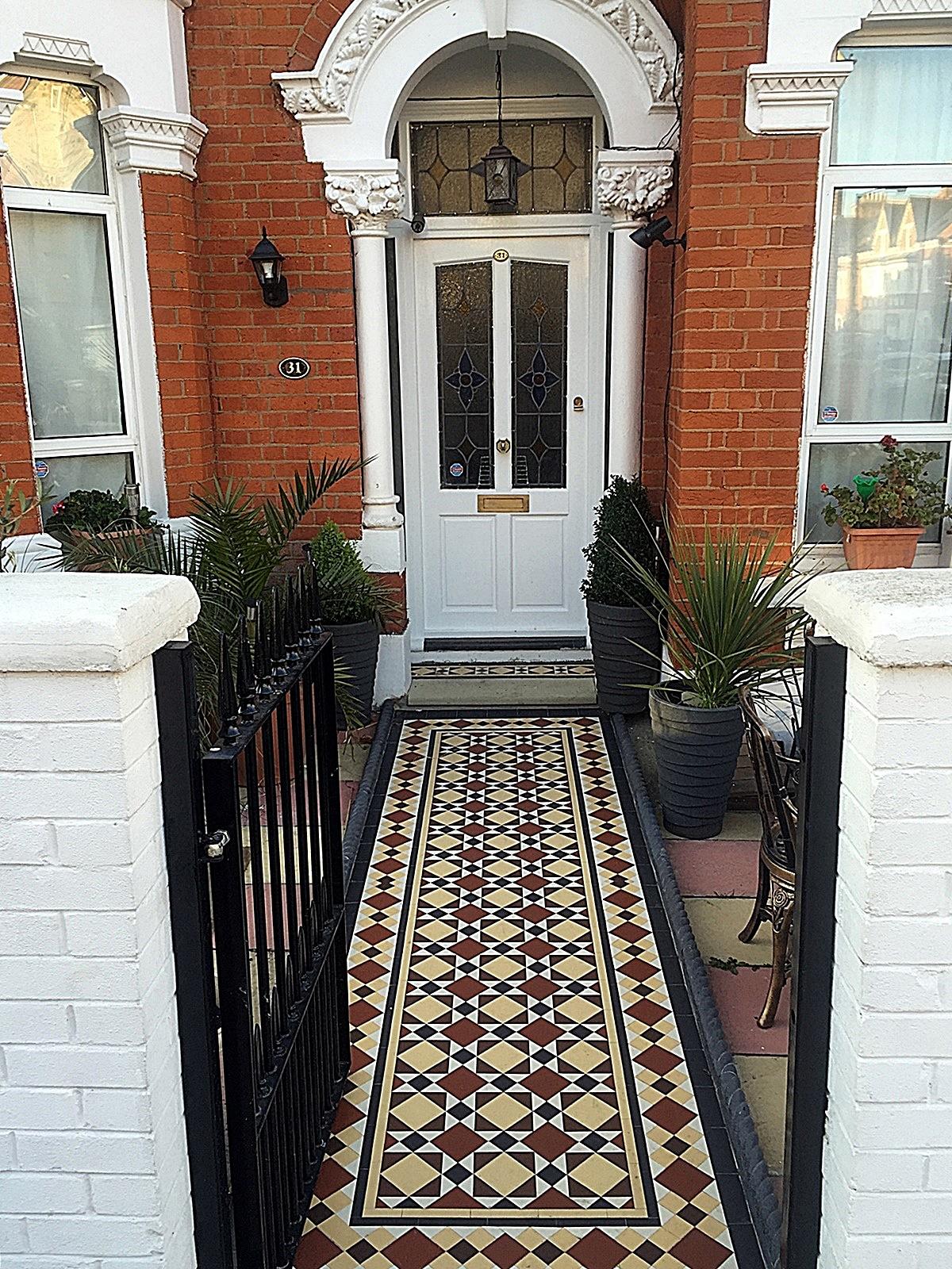 Metal gate rails white brick wall painting multi colour mosaic front garden company iron tile path London Wandsworth Balham Clapham