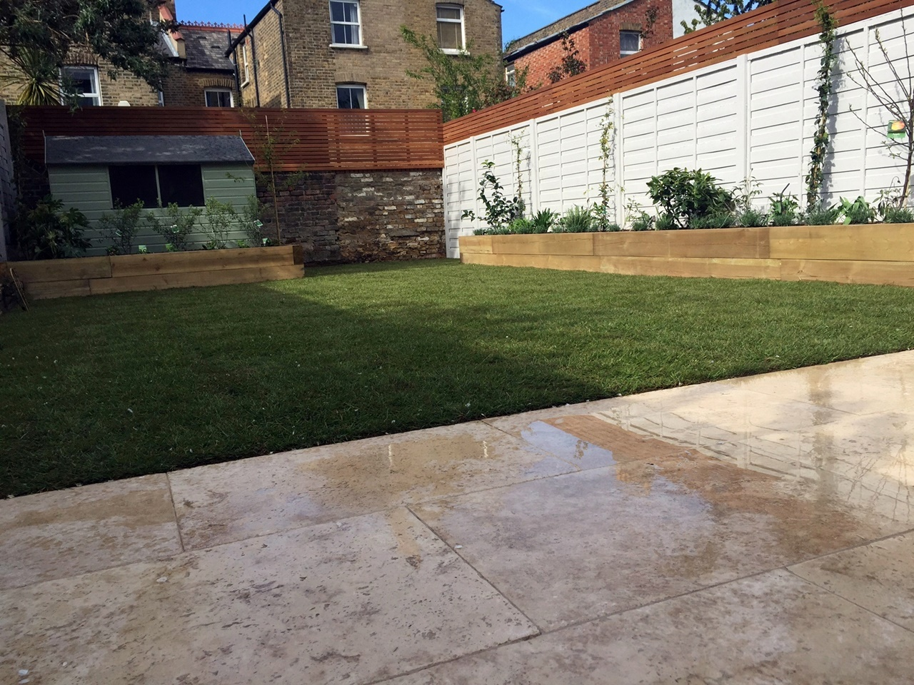 Hardwood privacy screen travertine paving fencing painted planting grass London Dulwich Battersea Clapham