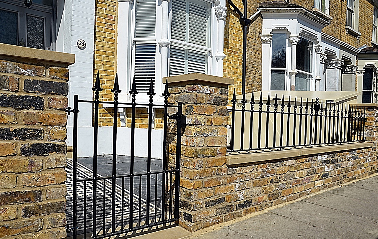 Metal gate rails brick wall Yellow stock piers cap coping low maintenance London Wandsworth Clapham Balham