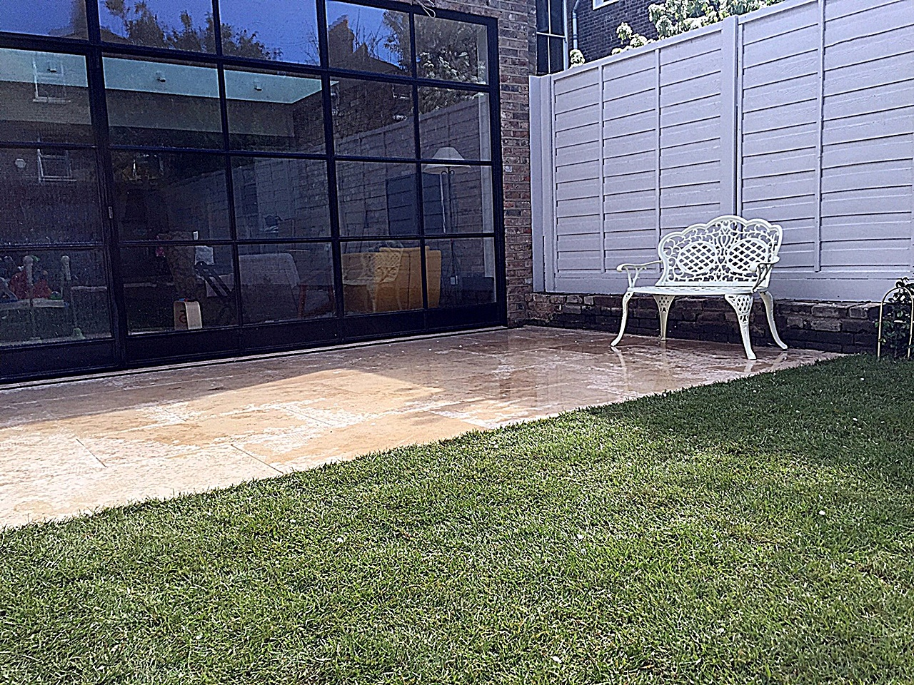 Privacy screen hardwood painted  fence real grass travertine paving fence planting Balham Wandsworth Clapham London