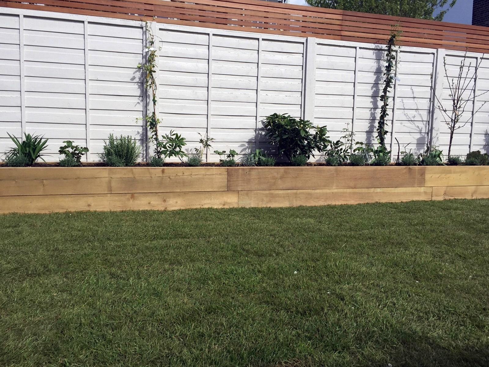 Travertine paving pastel shade painted fence hardwood screen Dulwich London Clapham Balham