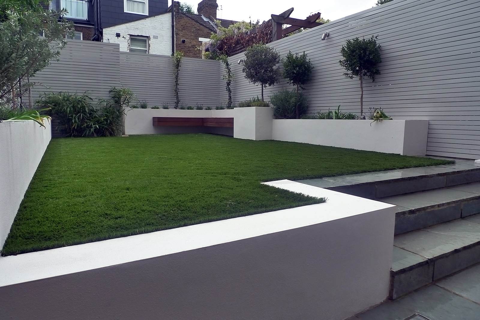 artificial grass easi grass grey painted fences modern garden design fulham chelsea kensington mayfair westminster docklands london
