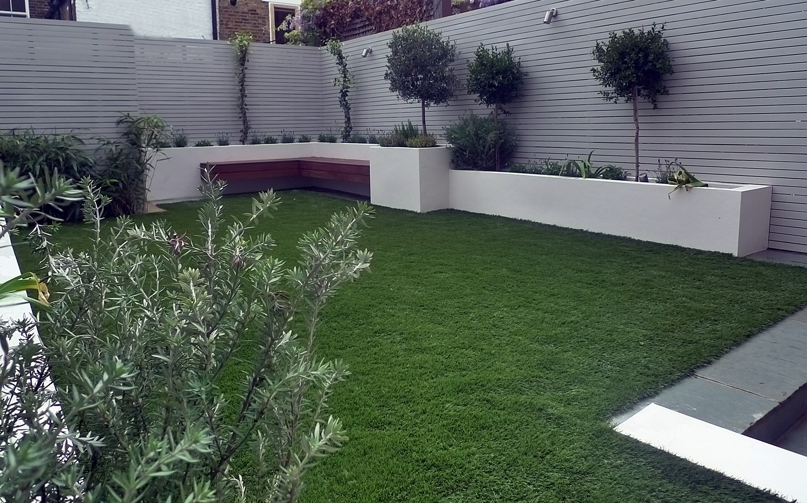Artificial grass easi grass grey painted fences modern for Garden design ideas artificial grass