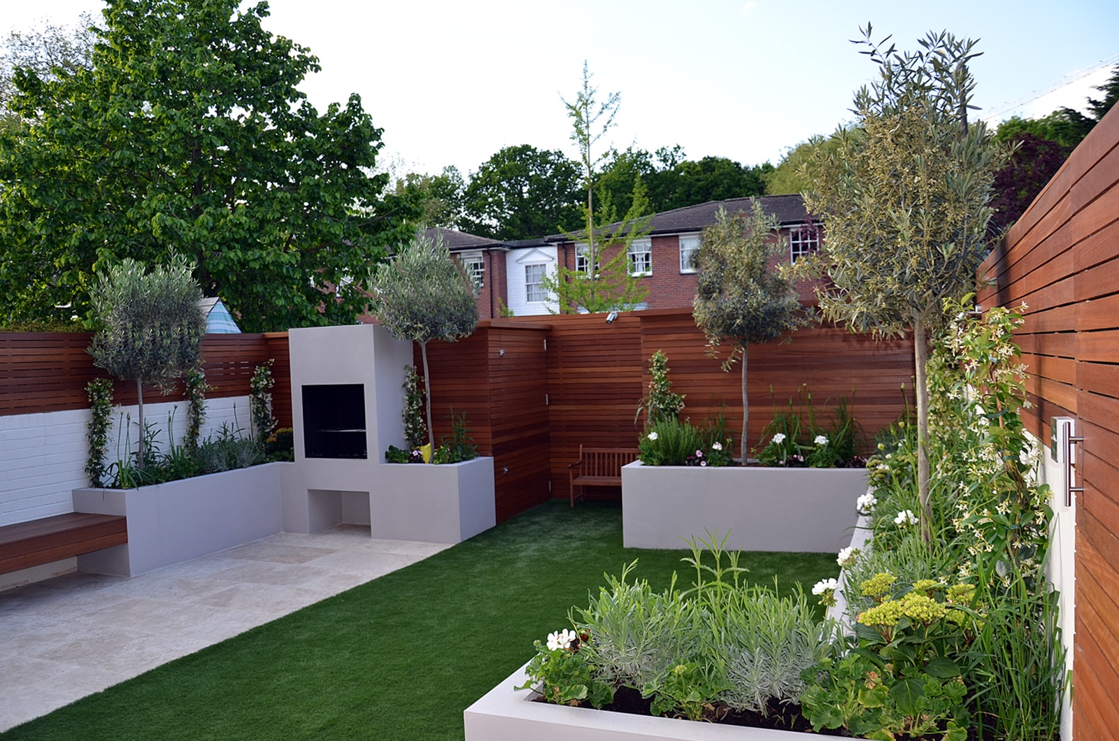 contemporary hardwood screen fence trellis slatted BBQ fireplace raised beds artificial grass cream paving london