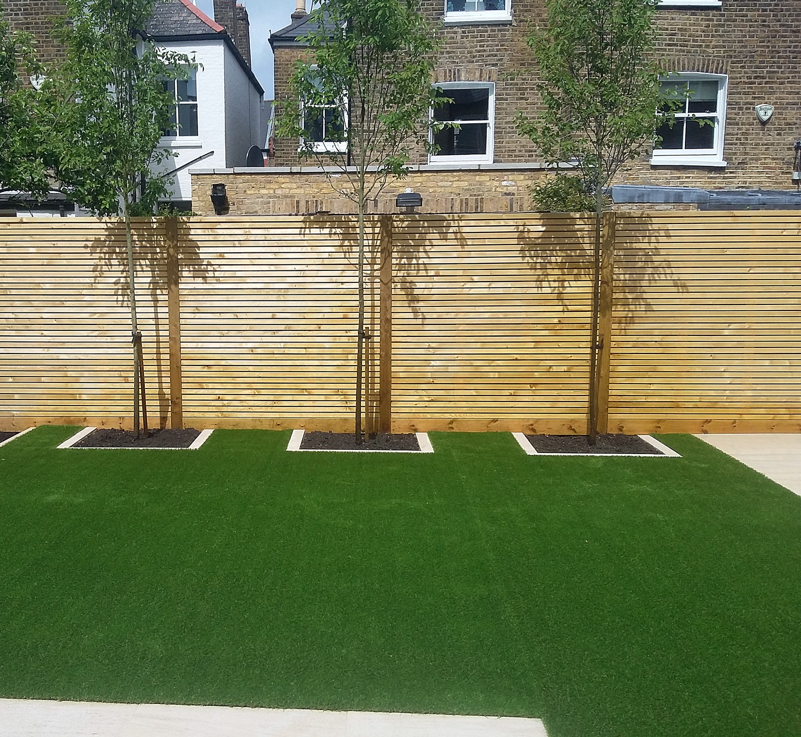 easi grass artificial lawn  slatted softwood horizonal screen fence trellis balham clapham battersea london