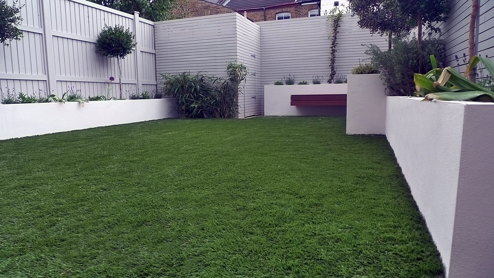 fake grass easi grass turf raised beds slatted horizontal fence screen painted grey london