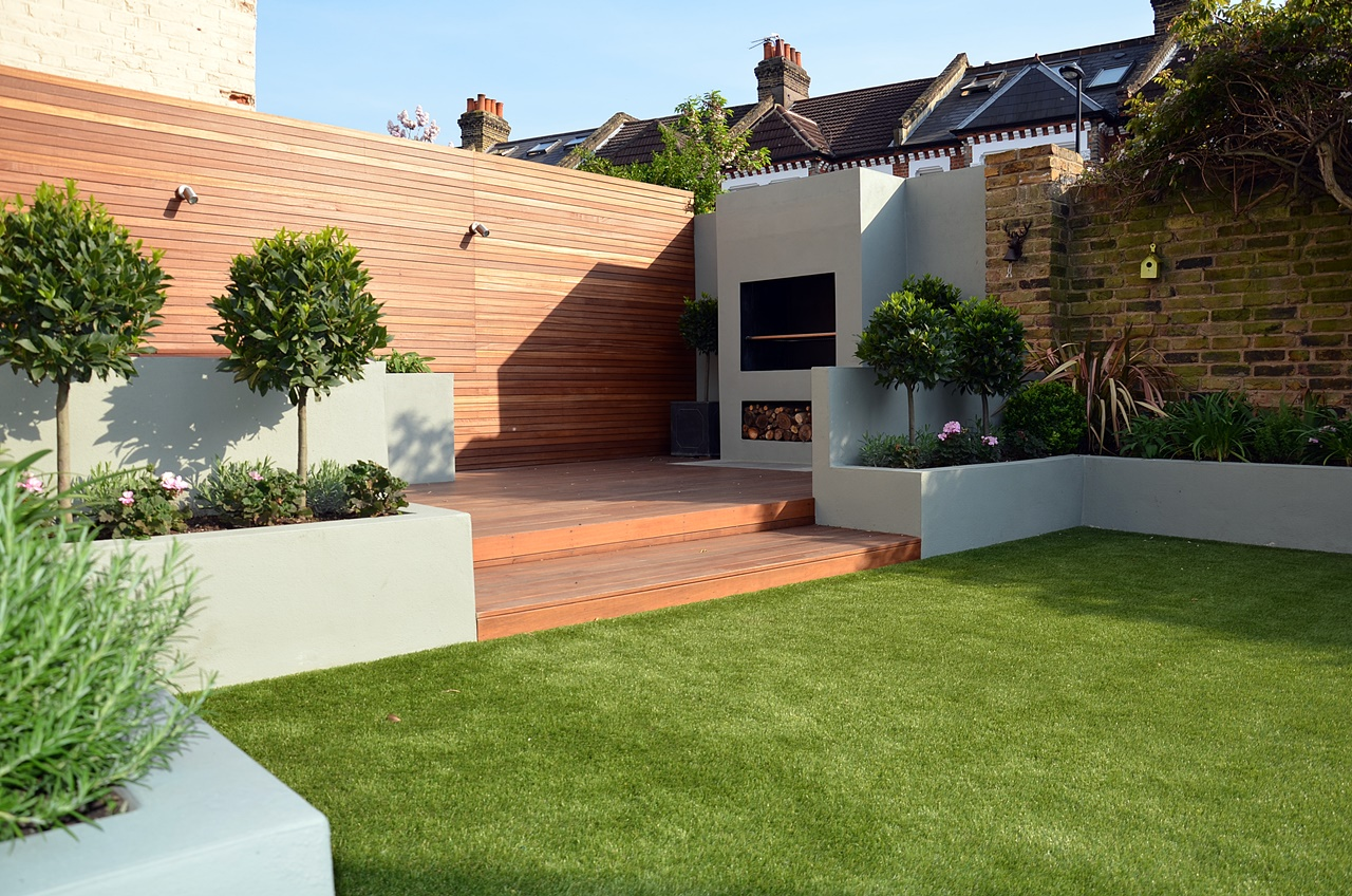fireplace raised beds hardwood decking modern garden design london