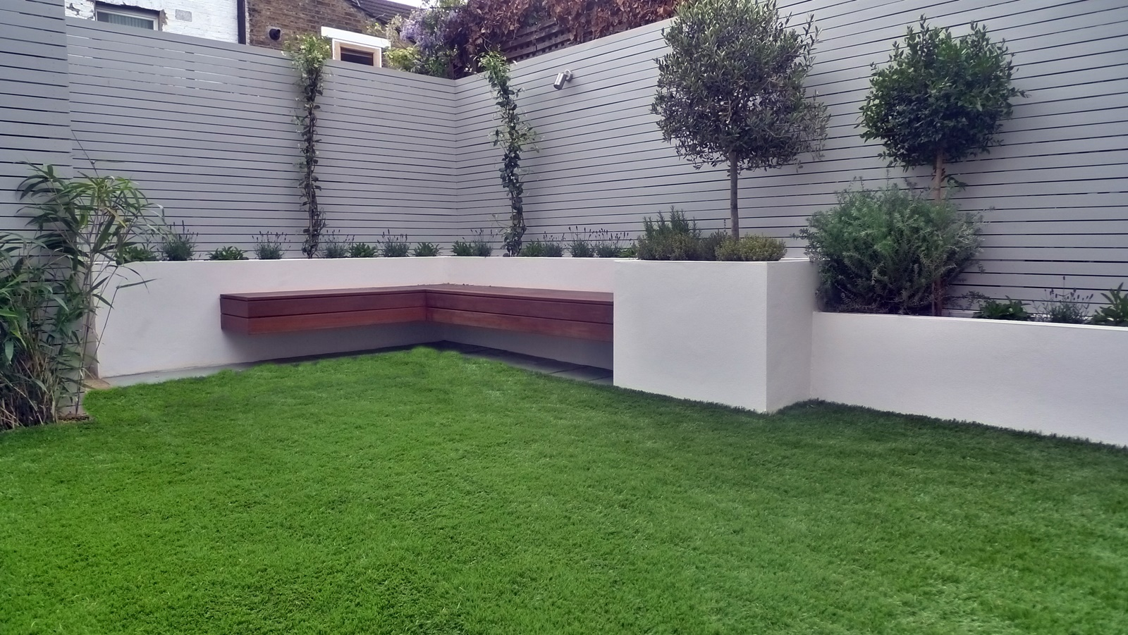 floating hardwood bench slatted hardwood cedar horizontal privacy screen fence raised beds artificial grass dulwich balham peckham forest hill clapham battersea vauxhall london