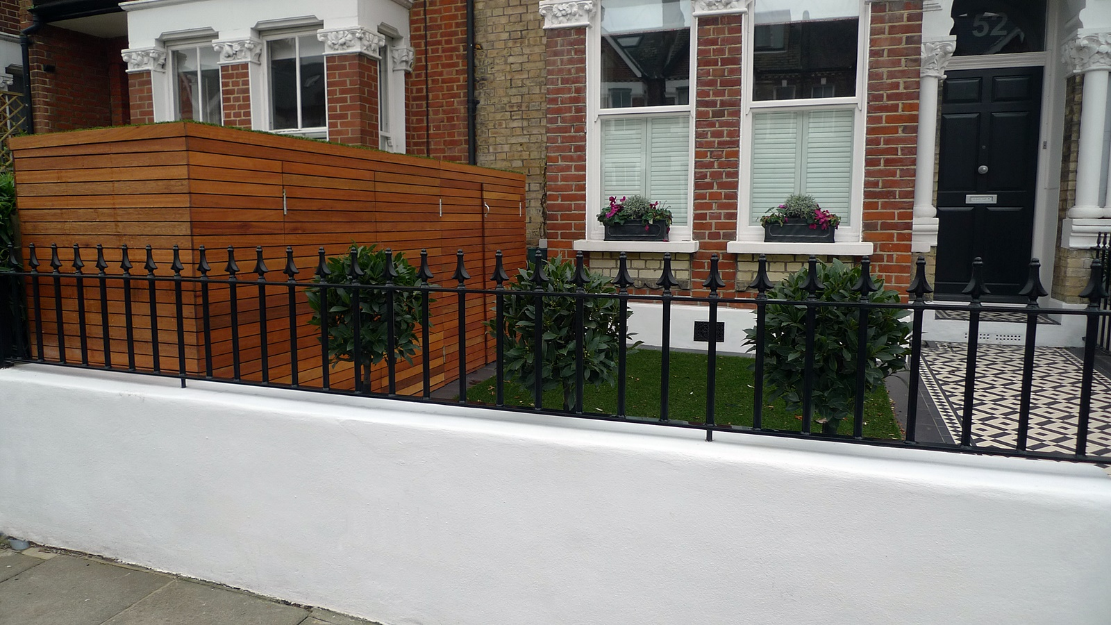 front garden design clapham london victorian mosaic tile path render  metal wrought iron rail topiary bay and bespoke hardwood bike and bin store wandsworth chelsea kensington battersea