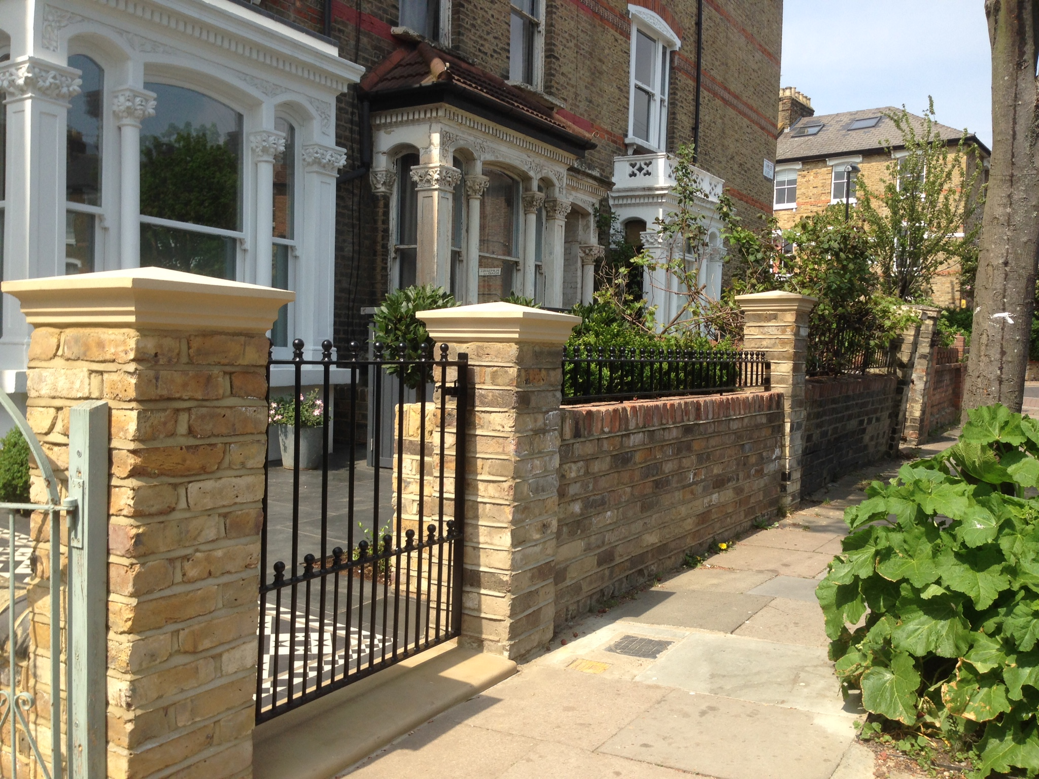 front garden yellow brick wall with buff coping and metal rail and gate clapham islington kensington holland park chelsea fulham london