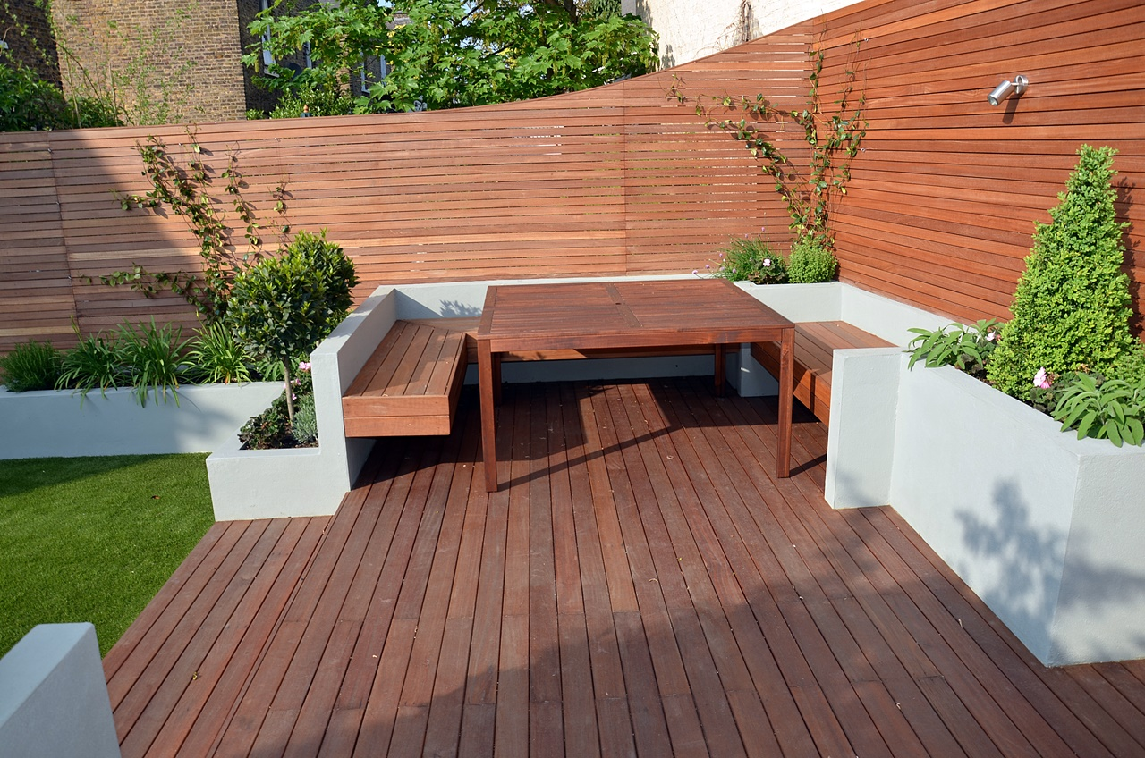 Modern garden design artificial grass raised beds hardwood for Images of garden decking