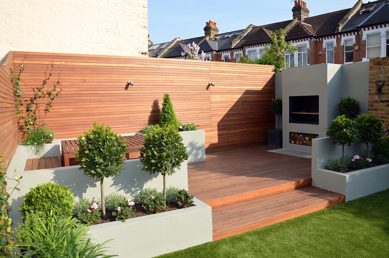Modern garden design artificial grass raised beds hardwood for Fireplace on raised deck