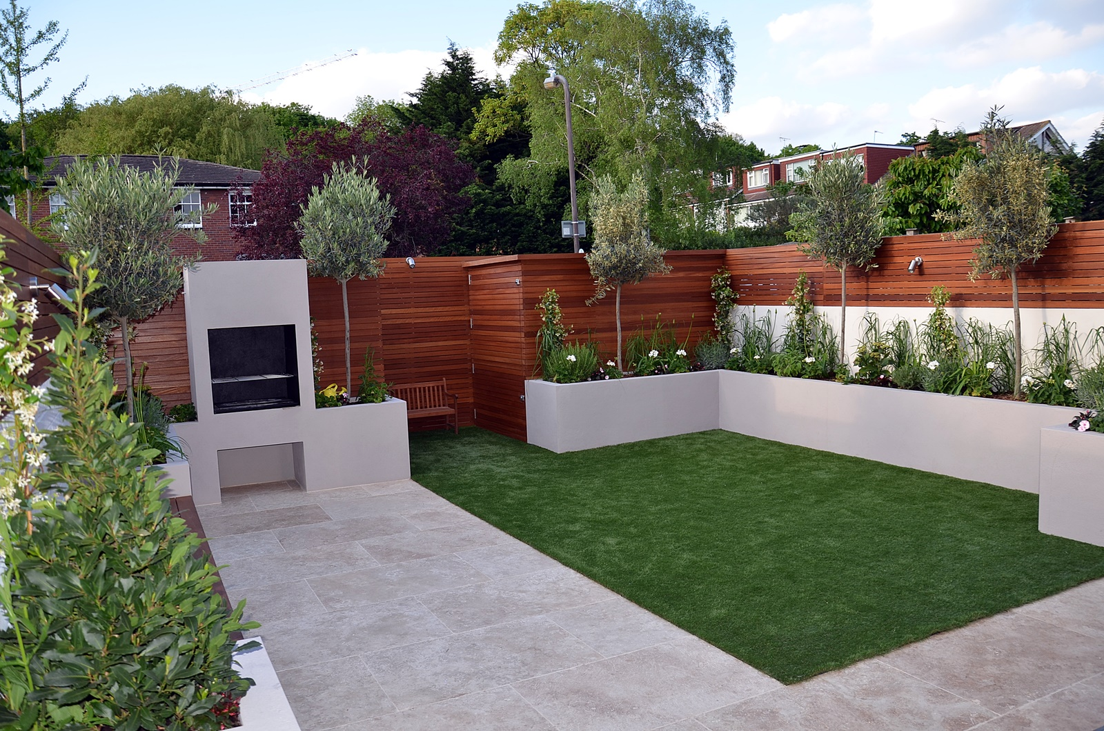 hardwood privacy screen bespoke trellisscreen fence raised beds paving BBQ fireplace garden designer london