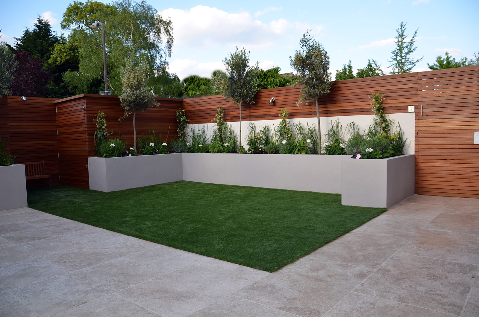 hardwood screen grey render raised beds travertine cream paving bespoke storage modern garden designer wimbledon cheam putney wandsworth london