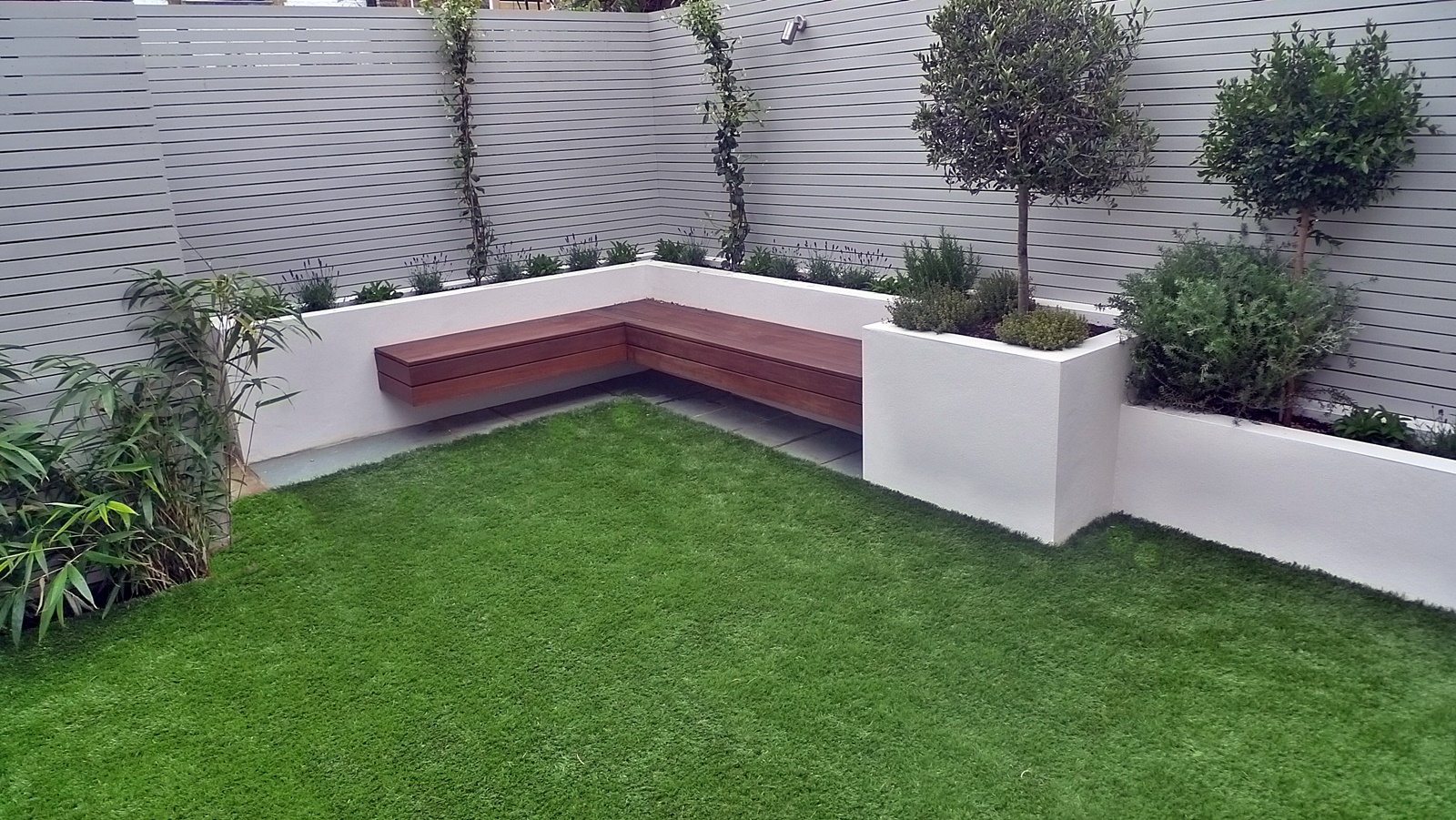 Artificial grass easi grass grey painted fences modern garden design ...