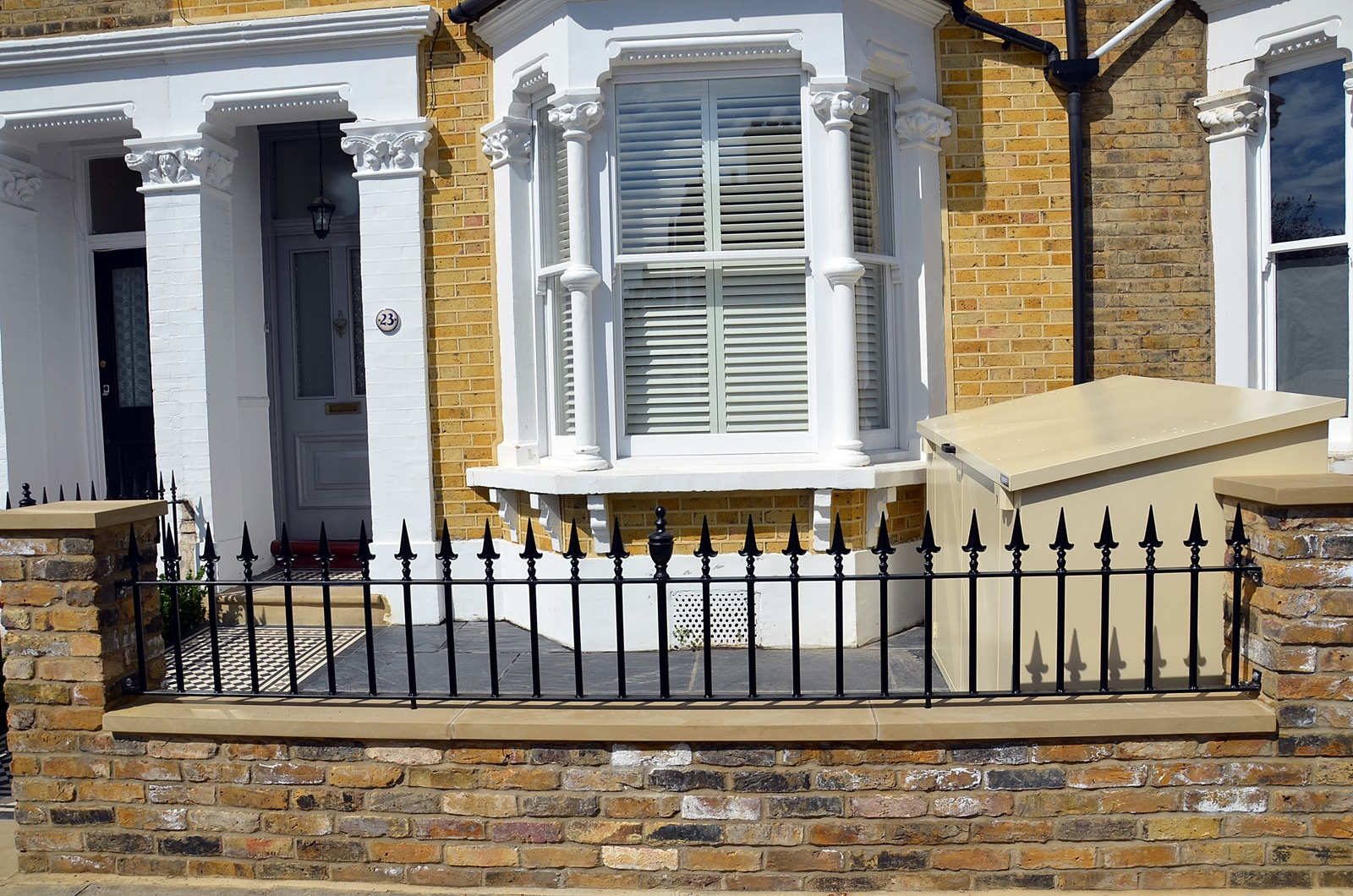 london brick wall yellow stock brick heavy metal rail and gate clapham balham streatham dulwich forest hill