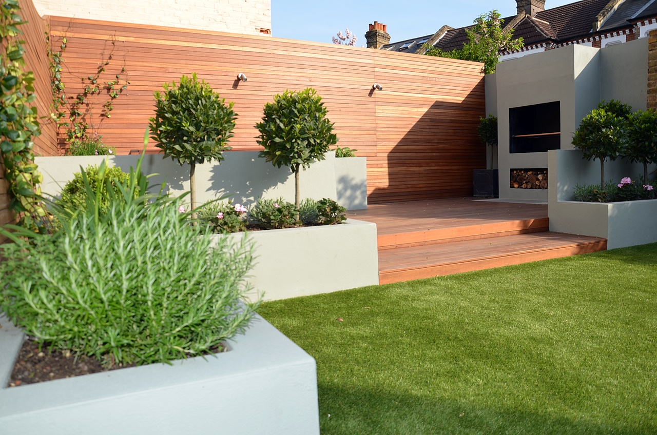 modern garden design hardwood screen and deck fireplace bbq bespoke raised grey beds topiary balham clapham batterse fulham chelsea london