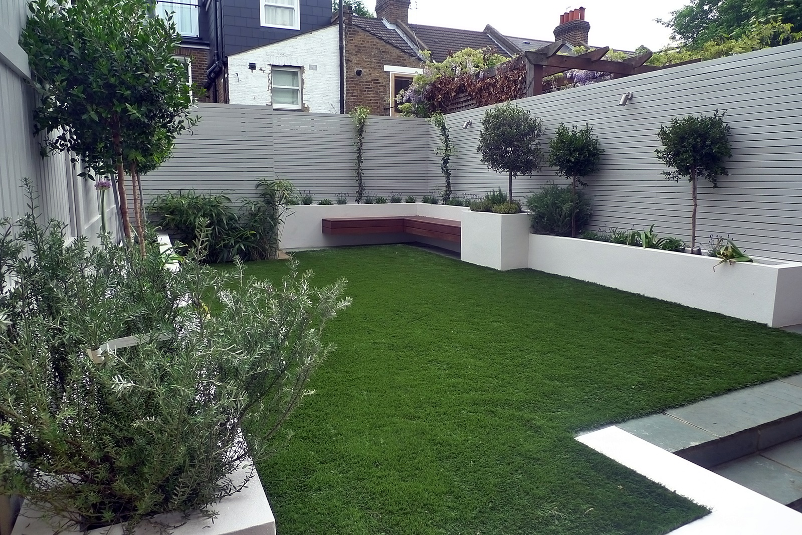 Artificial grass easi grass grey painted fences modern ...