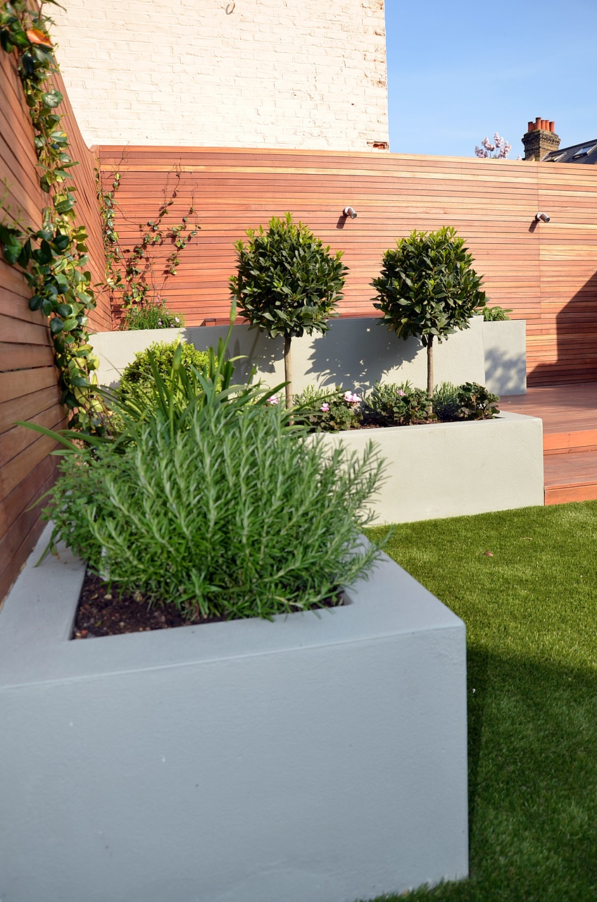 Modern garden design artificial grass raised beds hardwood for Small low maintenance gardens