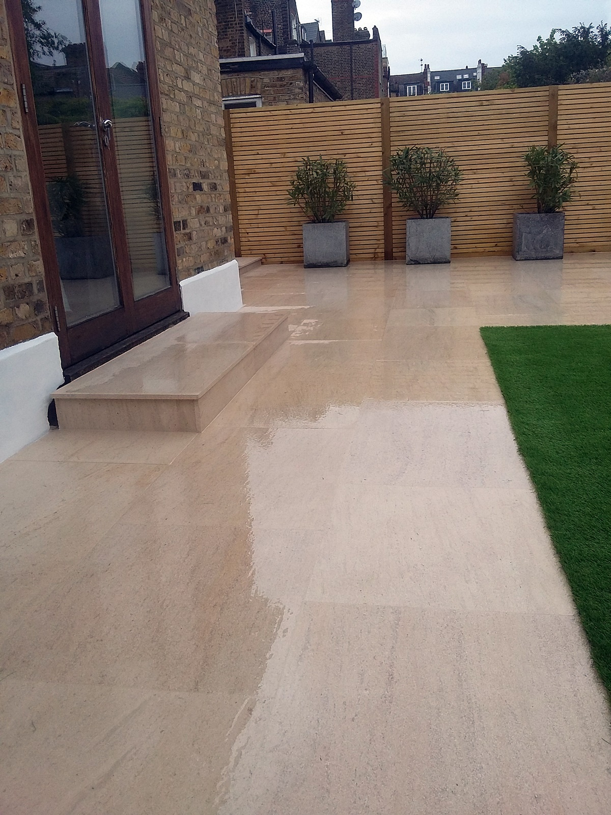 sawn limestone paving patio paving softwood slatted horizontal screen balham clapham putney wimbledon london