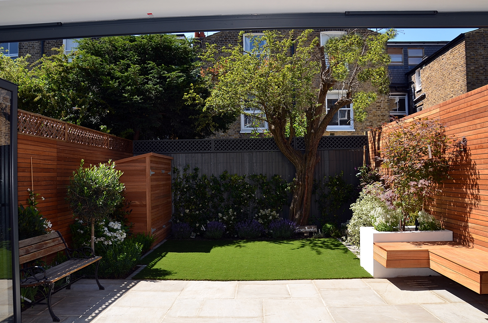 grey paving and fence hardwood horizontal privacy screen artificial grass